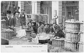 Photo:A porter can be seen in the background carrying baskets on his head