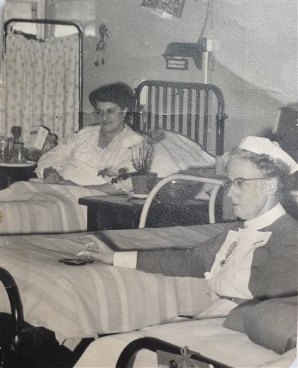 Photo:In this picture that Carla talks about, a nurse at St. Peter's hospital smokes next to Carla's mother's hospital bed.