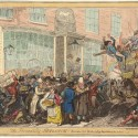 Photo:A satirical cartoon of a traffic accident caused by a disorderly mass of pedestrians. A coach and pair,  runs down two men and nearly overturns a cart to its right. outside the White Horse coaching terminus and Hatchett's coffee house in Piccadilly.  A fruit seller can be seen in the foreground and the scene includes a black man to the left.
